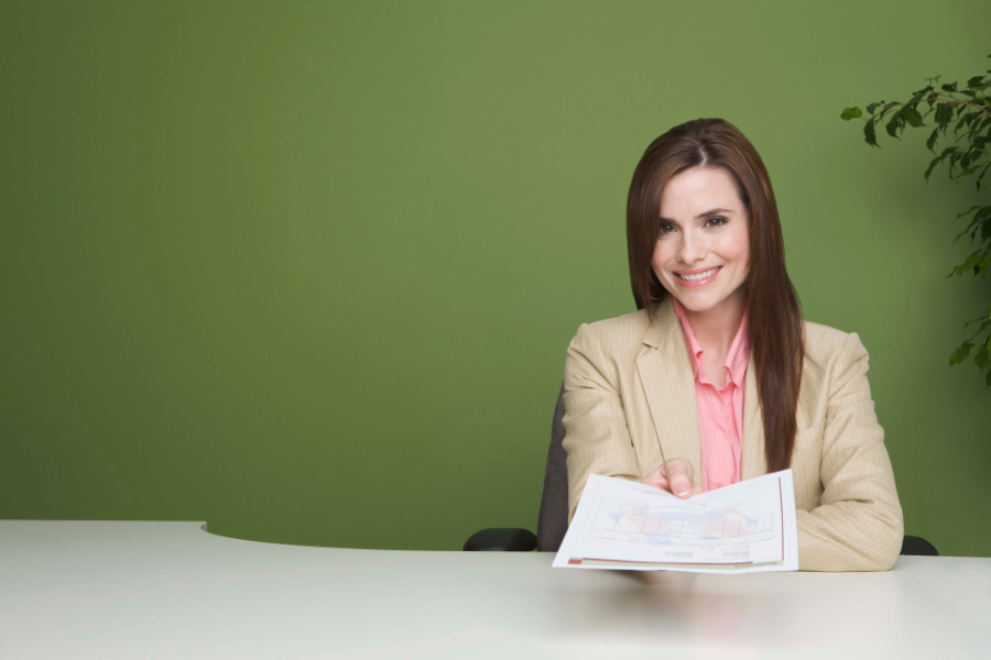 business woman passing papers