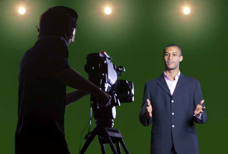 male reporter on green screen