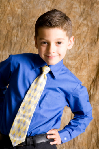 young boy in tie posed on brown photo background