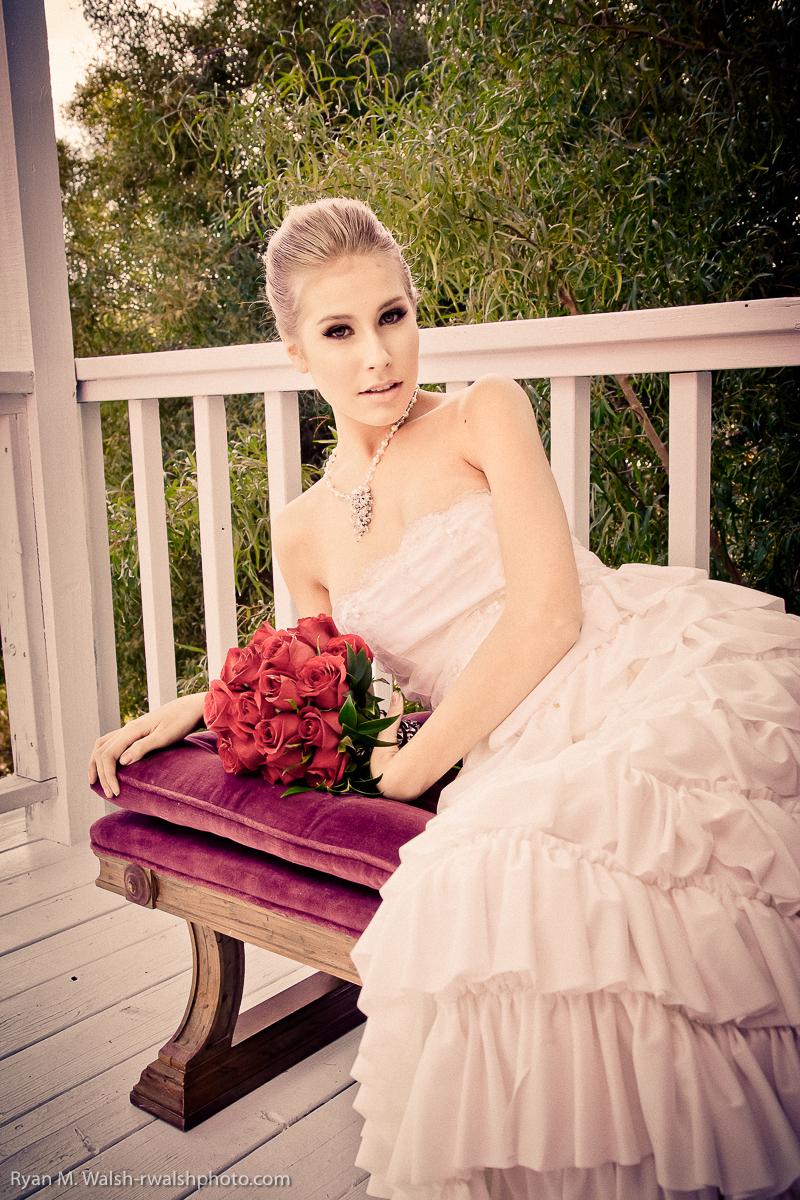 bride laying on bench