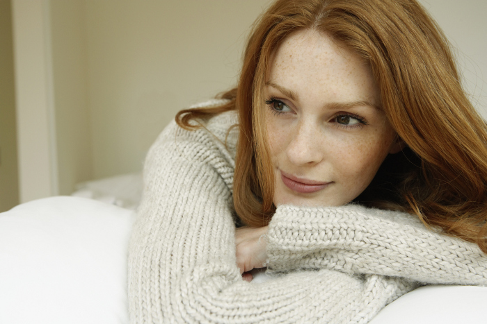 closeup-portrait-of-redheaded-female-on-bed