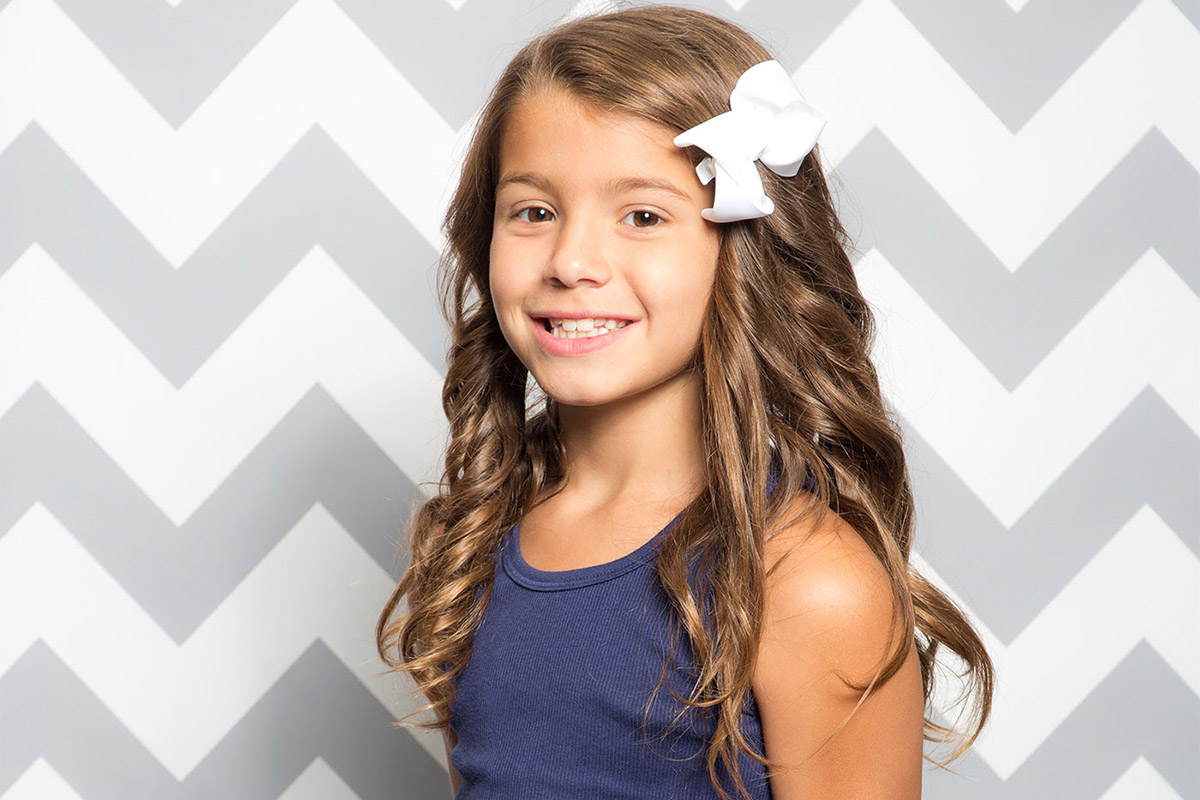 kid portrait on gray white chevron printed paper backdrop