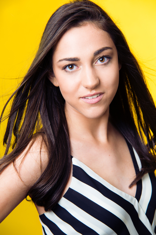 female head shot on yellow background