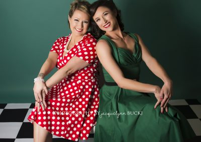 Flirtatious & Fierce Pin-up Looks Created With Primary Red and Teal Backdrops