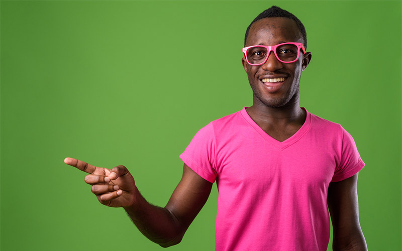 male vlogger on green seamless backdrop for youtube